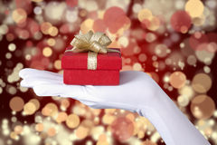 Christmas gift over defocused light Royalty Free Stock Photo