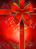 Christmas gift package. With a red bow Royalty Free Stock Images