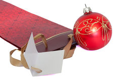 Christmas gift package. With a christmas ornament isolated on white Royalty Free Stock Photos