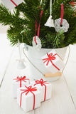 Christmas gift parcels, sweets and a Christmas tree Stock Image