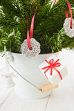 Christmas gift parcels, sweets and a Christmas tree Royalty Free Stock Photo