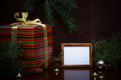 Christmas gift and photo frame. Royalty Free Stock Photography