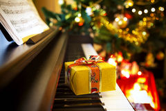 Christmas gift on piano Stock Photos