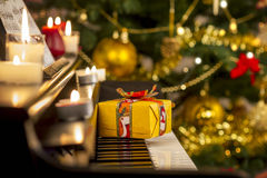 Christmas gift on piano Royalty Free Stock Photo