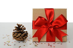Christmas gift and pine cone Royalty Free Stock Photo