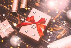 Christmas gift or present box wrapped in kraft paper with decoration on rustic background from above. Flat lay style. top view. Bright and festive stock photos