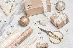 Christmas gift or present box wrapped in kraft paper with decoration on rustic background from above. Flat lay style. Top view. Bright and festive Stock Photo