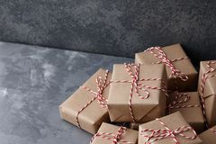 Christmas gift or present boxes wrapped in kraft paper royalty free stock images