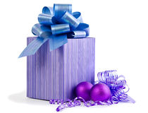 Christmas gift with Purple Ball and ribbon bow isolated on white Royalty Free Stock Photos