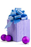 Christmas gift with Purple Ball and ribbon bow Stock Photos