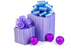 Christmas gift with Purple Ball and ribbon bow Royalty Free Stock Images