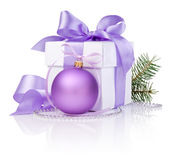 Christmas gift with Purple Ball, tree branch. And ribbon bow isolated on white background Stock Images