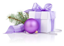 Christmas gift with Purple Ball and tree branch. Christmas gift with Purple Ball, tree branch and ribbon bow  on white background Stock Images