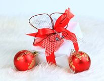Christmas gift with red balls Stock Image