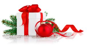 Christmas gift with red balls and branch firtree Royalty Free Stock Image