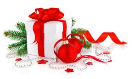 Christmas gift with red balls and branch firtree Stock Photos