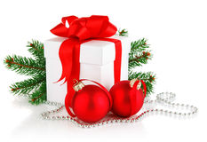 Christmas gift with red balls and branch firtree Royalty Free Stock Photography