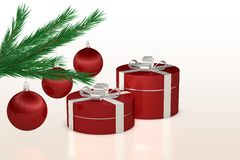 Christmas gift, red balls and fir branch. On white background Royalty Free Stock Image