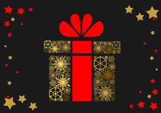 Christmas gift with a red bow on a dark background. Golden Christmas gift with a red bow on a dark background Royalty Free Stock Photography