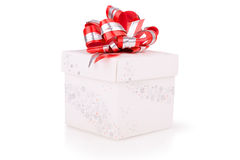 Christmas gift with red bow. Isolated Royalty Free Stock Photo