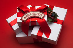 Christmas gift with red bow and Merry Christmas card Royalty Free Stock Photography