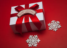 Christmas gift with red bow and Merry Christmas card Stock Photo