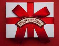 Christmas gift with red bow and Merry Christmas card Royalty Free Stock Image