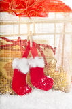 Christmas gift in red and gold in the snow. Royalty Free Stock Photo