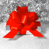 Christmas gift with red ribbon on shiny background Stock Images