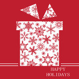 Christmas gift on red with snowflakes. Christmas card on red background white silhouette gift with a snowflake inside and the words Royalty Free Stock Image