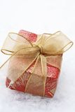Christmas gift with red wrapping and bow. Stock Photo