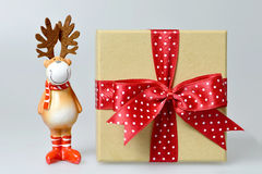 Christmas gift and reindeer ornament Royalty Free Stock Photo