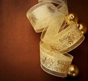 Christmas gift ribbon and baubles Royalty Free Stock Photos