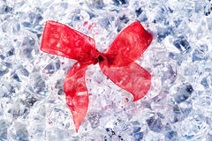 Christmas gift ribbon loop on winter ice Stock Photo