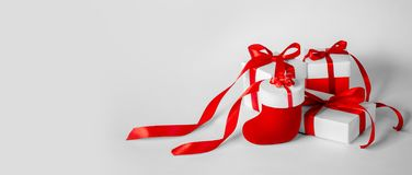 Christmas Gift`s in White Box with Red Ribbon on Light Backgroun stock image