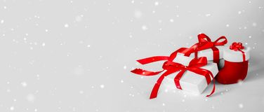 Christmas Gift`s in White Box with Red Ribbon on Light Backgroun stock photography