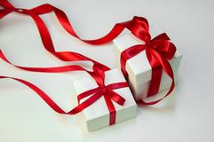 Christmas gift`s in white box with red ribbon on light background. New year holiday composition Stock Photos