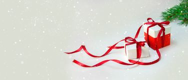 Christmas Gift`s in White Box with Red Ribbon on Light Background. New Year Holiday Composition Banner. Copy Space Stock Photo