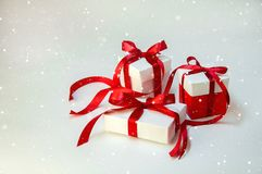 Christmas Gift`s in White Box with Red Ribbon on Light Background. New Year Holiday Composition Royalty Free Stock Image