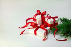 Christmas Gift`s in white box with red ribbon on light background. New year holiday composition. Copy space Royalty Free Stock Image