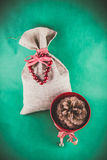 Christmas gift sack and pine cone Royalty Free Stock Images