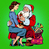 Christmas gift. Santa Claus and a beautiful girl Royalty Free Stock Photos