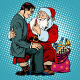 Christmas gift. Santa Claus and businessman Stock Images