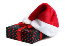 Christmas gift and santa hat Royalty Free Stock Photo
