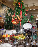 Christmas gift shop in Longwood Gardens. Gifts souveneers and Christmas tree decorated with pomegranates and apples. glassware and silver cutlery Stock Images