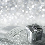 Christmas gift in silver. And stars Stock Images