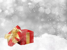 Christmas gift on silver background. Christmas red gift with golden bow on silver background Royalty Free Stock Photo
