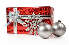 Christmas gift with silver balls. On white royalty free stock image
