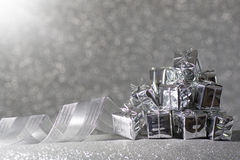 Christmas gift in silver and a ribbon Royalty Free Stock Photo