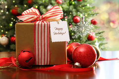 Christmas gift sitting on a table Royalty Free Stock Photos